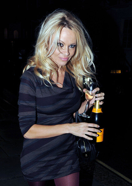 Pamela Anderson Is Actress Activist And Champagne Fan